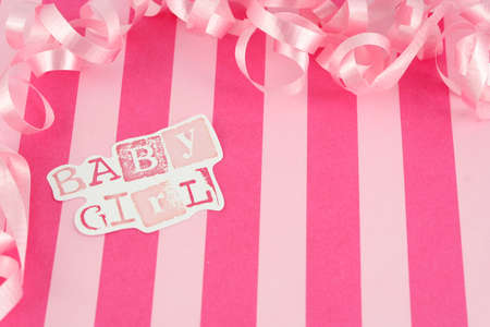 pink  girl background with stripes and pink curled celebratory ribbon