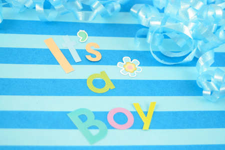 celebratory its a boy text background with  ribbon suitable for new baby Banco de Imagens