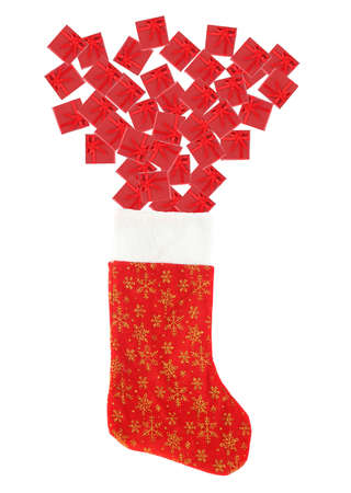stuffed festive christmas stocking overflowing with small gift boxes isolated on a white background