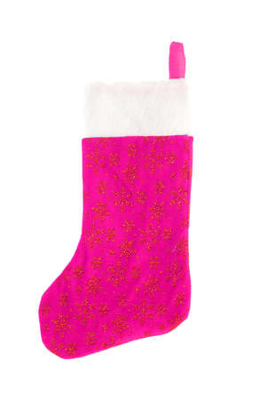 pink festive christmas stocking with gold stars hanging isolated on a white background