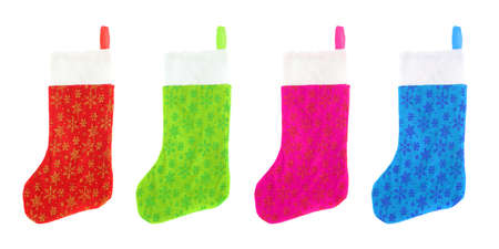 stuffer: different colored festive  christmas stockings isolated on white Stock Photo