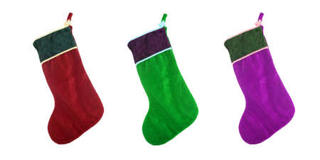 different colored festive  christmas stockings isolated on white Stock Photo