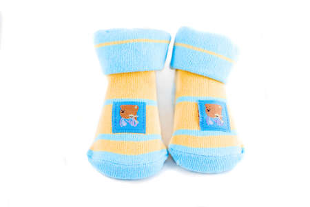 little baby socks with teddy bears on a white background