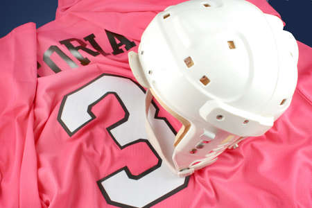 padding: professional protective hockey helmet for  protecting ones head, on pink number 3 jersey