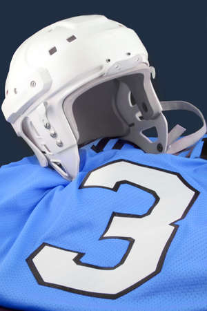 padding: professional protective hockey helmet for  protecting ones head, on blue number 3 jersey