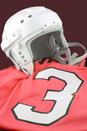 padding: professional protective hockey helmet for  protecting ones head, on red number 3 jersey Stock Photo