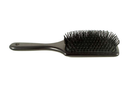 black flat hairbrush on a white background