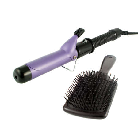 styler: single barrel curling iron used on straight hair to make it curly and flat hairbrush ready for hairstyling