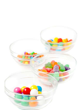different colorful candy in clear dishes on a white background Stok Fotoğraf