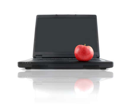 workplace wellness: a business laptop with shiny red apple depicting workplace wellness