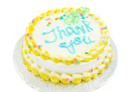 thanking: yellow and white frosted festive cake with thank you written in blue