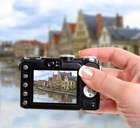 gabled:  taking a picture of architecture along a canal in Ghent,  Belgium Stock Photo