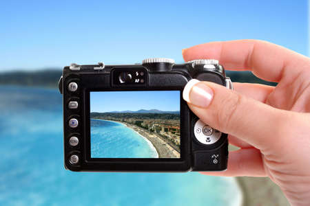 vacationing: Taking a picture with an overhead view of beaches in Nice, France