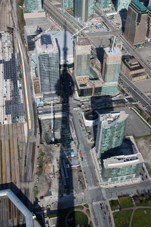Panorama of downtown high rise buildings in Toronto, Ontario, Canada with the CN Tower shadow  photo