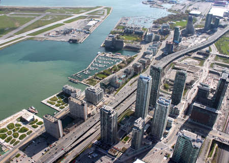lakeshore: Panorama of downtown high rise condominiums and a yacht marina along the Lakeshore with part of the Island airport showing in Toronto, Ontario, Canada Stock Photo