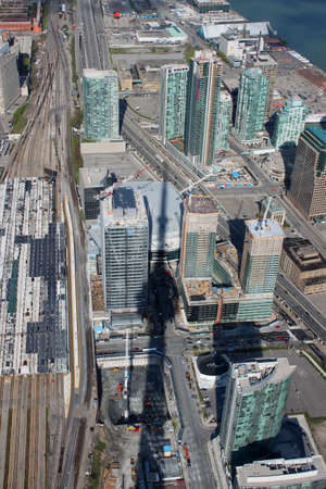 Panorama of downtown high rise buildings in Toronto, Ontario, Canada with the shadow of the CN Tower photo