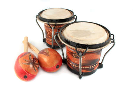 Rhythm percussion instruments like maracas and bongo drums on a white background Stock Photo