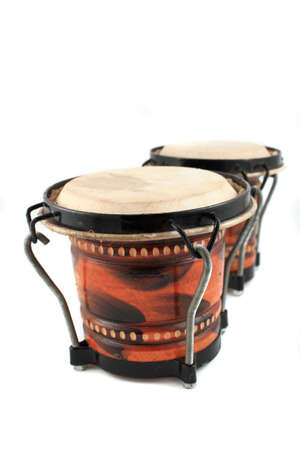 Rhythm percussion instruments bongo drums on a white background photo