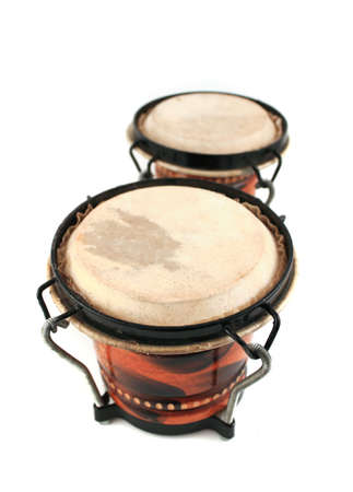 Rhythm percussion instruments bongo drums on a white background