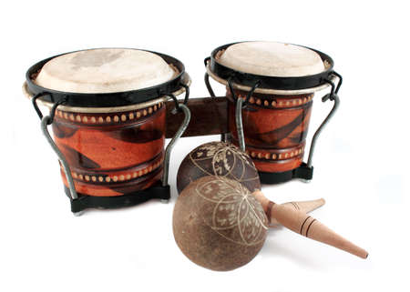 Rhythm percussion instruments like maracas and bongo drums on a white background photo