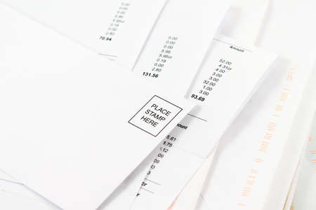 prompt: Different bills to be paid with blank envelope on top to mail prompt payments