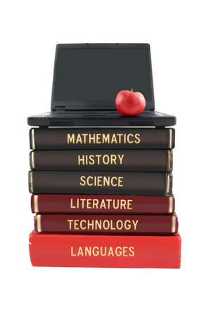 School subjects textbooks like mathematics, history, science, and technology with laptop and apple on a white background Stock Photo