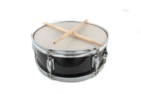 Snare drum and drumsticks on a white background