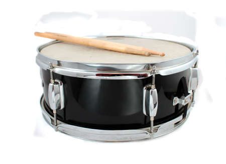 Snare drum and drumsticks on a white background (short depth of field) Stock Photo