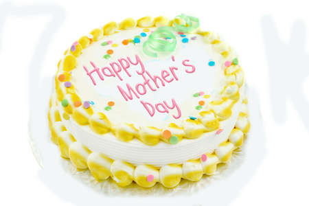 Happy mothers day cake in yellow and white frosted decorations