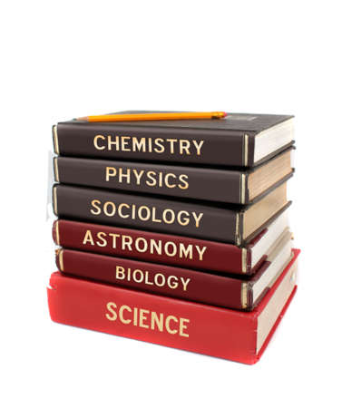 Tall stack of different university level science textbooks like chemistry, physics, and astronomy  on a white background