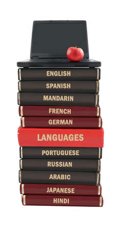 Languages textbooks like english, spanish, mandarin, french and portuguese with laptop on top for educational purposes