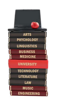 University level subject textbooks stacked on a laptop with apple on a white background photo