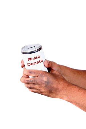 Homeless man with dirty hands holds a tin can asking for change, tin says please donate photo