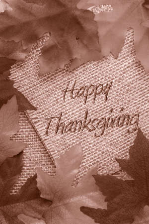 fall background in sepia covering twine rope paper saying Happy Thanksgiving photo
