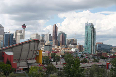 Skyline view of highrise office and apartment buildings in Calgary, Alberta, Canada with the Saddledome in the foreground photo