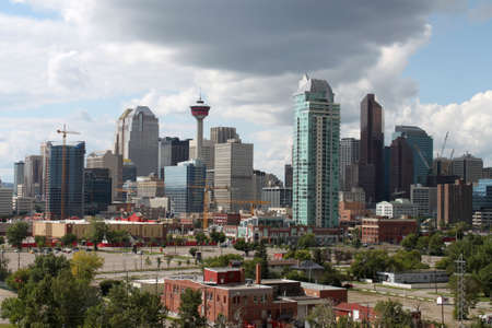Skyline view of highrise office and apartment buildings in Calgary, Alberta, Canada  under dramatic dark and white clouds photo
