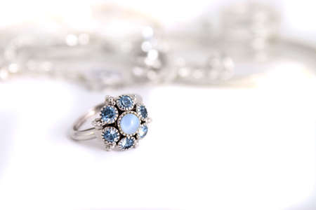 heirlooms: Blue colored stone rings with silver band in a white background  Stock Photo