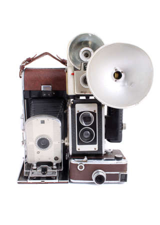 heirlooms: Old antique cameras in a pile on a white background Stock Photo