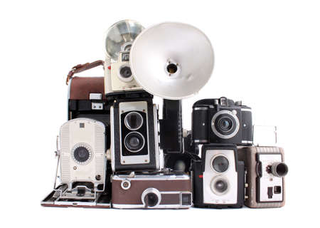 Old antique cameras in a pile on a white background Stock Photo