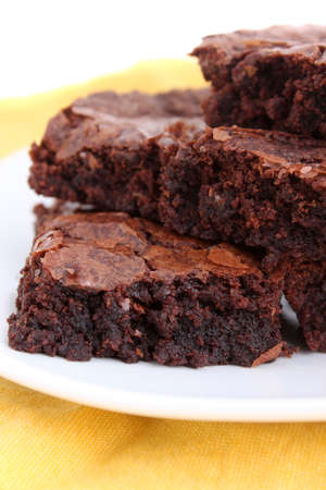Chocolate fudge brownies isolated on white background