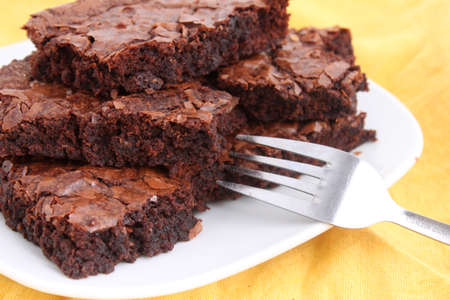 Chocolate fudge brownies on a plate with fork