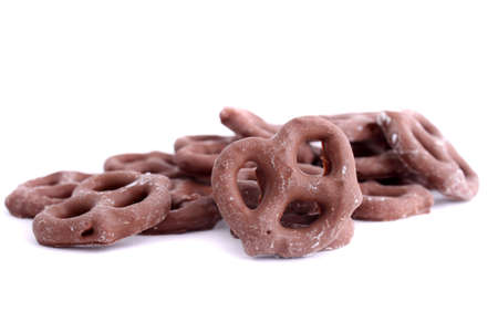 covered: Chocolate covered pretzel on a white background