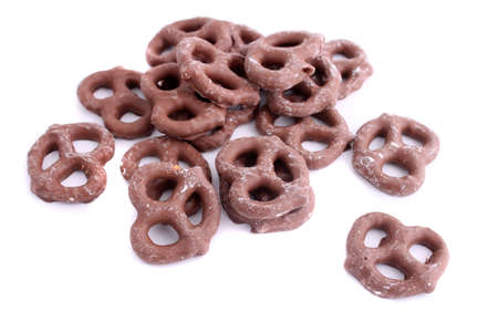 Chocolate covered pretzel on a white background