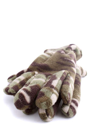 Warm camouflage style winter gloves on white background (not isolated)