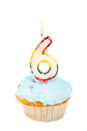 sixth birthday cupcake with blue frosting on a white background photo