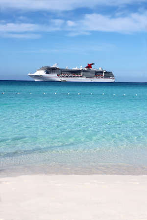 beach cruiser: Looking at a cruise ship in the clear blue Caribbean ocean from a tropical beach