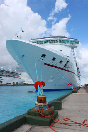 the mooring: Cruise ships in the clear blue Caribbean ocean docked in the port of Nassau, Bahamas