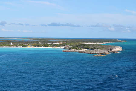 cay: The island of Half Moon Cay in the Bahamas with beautiful turquoise blue waters