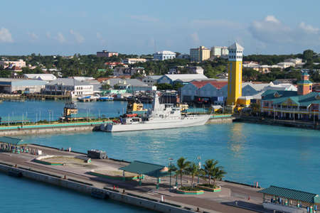 forefront: View of the port of Nassau with battleship and cruise ship docks in the forefront Stock Photo