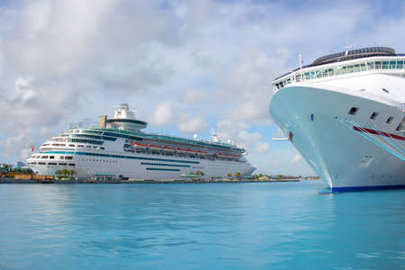 bahamas: Cruise ships in the clear blue Caribbean ocean docked in the port of Nassau, Bahamas